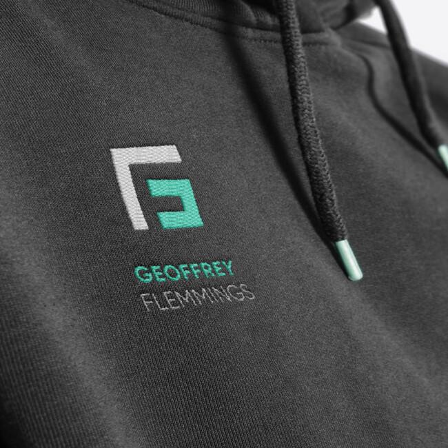 Broderie avec le logo Geoffrey Flemmings